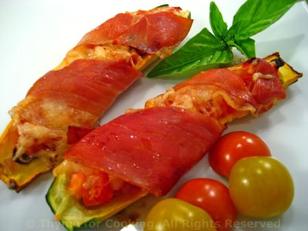 Zucchini, stuffed and wrapped in Prosciutto